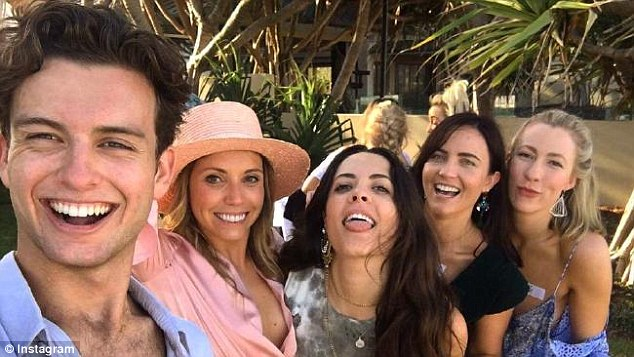 Wedding celebrations! Margot's brotherCameron, who flew back to Queensland on Saturday, was tagged in a photo at their wedding party with four of her friends