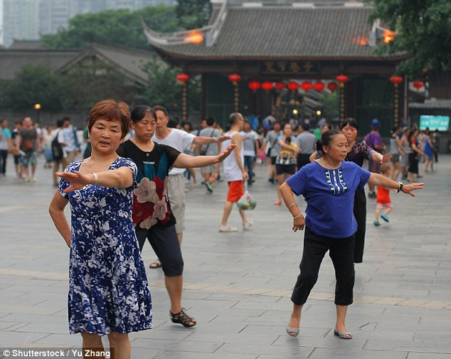 Square dancing: Middle-aged and retired women practise fan dancing and shadow boxing as morning exercise routine often in a square or plaza (file photo)