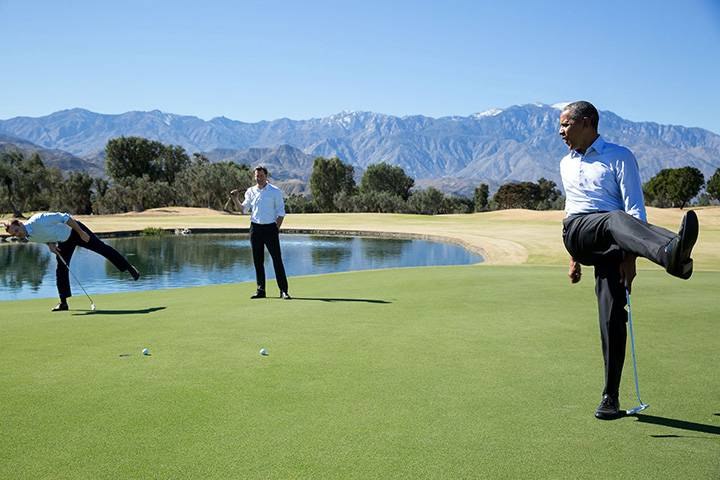 """Feb. 16, 2016: """"President Obama reacts as his putt falls just short during an impromptu hole of golf with staffers Joe Paulsen, left, and Marvin Nicholson after the U.S.-ASEAN Summit at the Annenberg Retreat at Sunnylands in Rancho Mirage, Calif."""""""