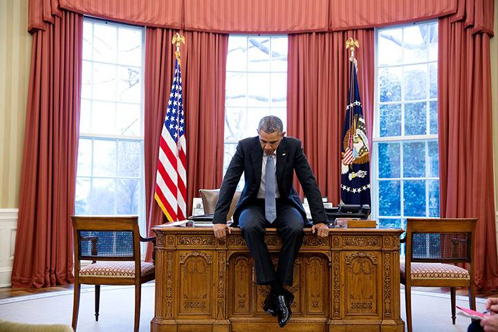 """Feb. 23, 2016: """"This photograph evokes the President in deep thought, which is not always an easy mood to convey. He was prepping with his national security staff before a teleconference with European leaders."""""""