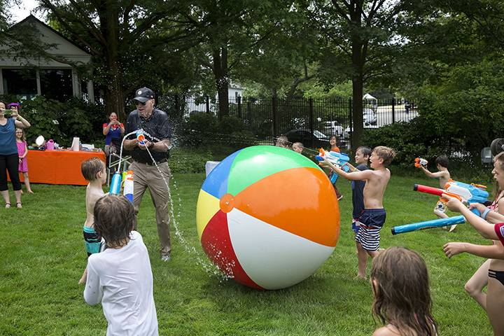 """June 4, 2016: """"The Vice President chases children and members of the press with a super soaker during the 2016 Biden Beach Boardwalk Bash held at the Naval Observatory Residence in Washington, D.C."""""""