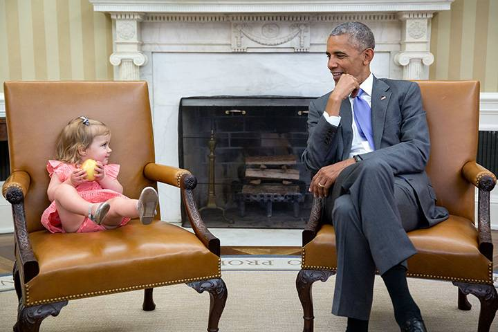 """June 22, 2016: """"The great thing about children is you just don't know what they will do in the presence of the President. So when David Axelrod stopped by the Oval Office with one of his sons' family, Axe's granddaughter, Maelin, crawled onto the Vice President's seat while the President continued his conversation with the adults. Then at one point, Maelin glanced over just as the President was looking back at her."""""""