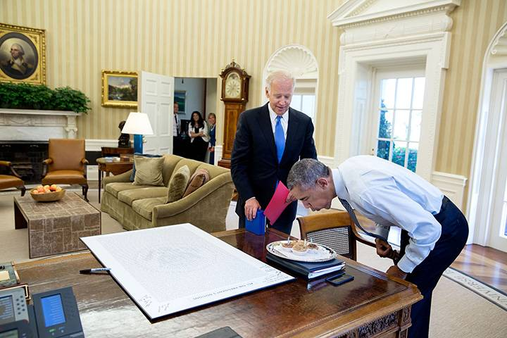 """Aug. 4, 2016: """"With some staff watching in the background, President Obama blows out candles after the Vice President surprised him with some birthday cupcakes."""""""