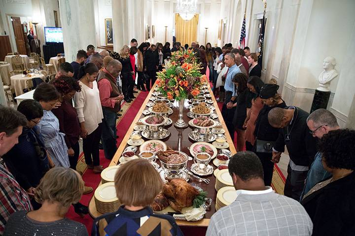 """Nov. 24, 2016: """"President Obama leads a prayer before hosting Thanksgiving dinner for family and friends on the State Floor of the White House."""""""