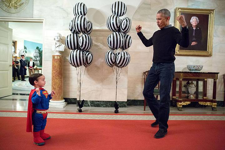 """""""The President was about to welcome local children for Halloween trick-or-treating when he ran into Superman Walker Earnest, son of Press Secretary Josh Earnest, in the Ground Floor Corridor of the White House. 'Flex those muscles,' he said to Walker."""""""