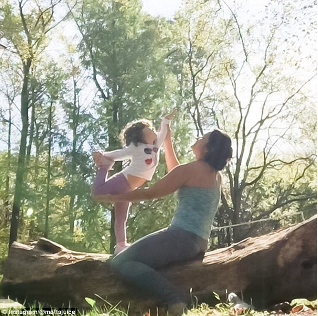 Instagram snaps show Mottajuice teaching her daughter sun salutations as they balance on a log