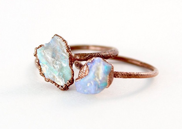An iridescent raw opal ring that's a little rough around the edges.