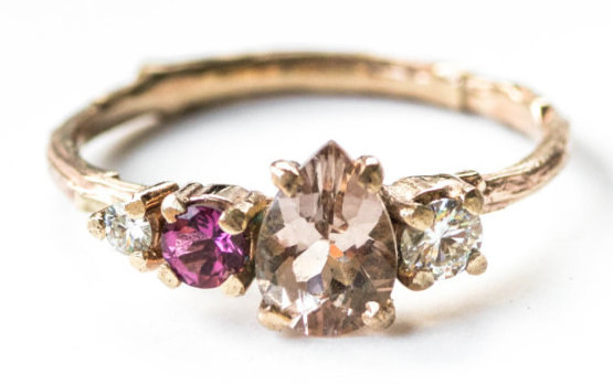 A clustered peach morganite, pink tourmaline, and moissanite ring that'll be the talk of the town.