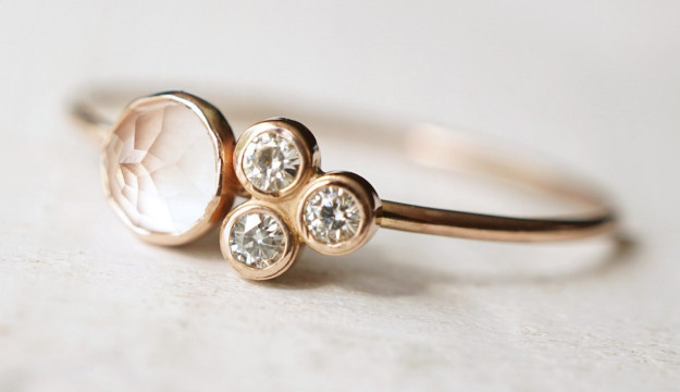 A rose quartz and moissanite ring that confirms that four is not a crowd.