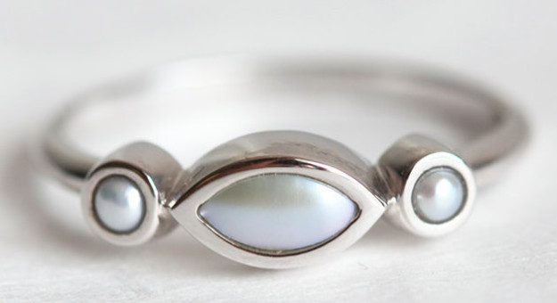 A classy marquise-shaped ring that gifts you three pearls of wisdom.
