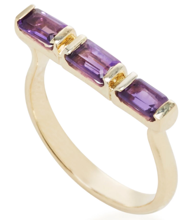 A polished amethyst ring for people who dream of having a vault of *purple* bars.