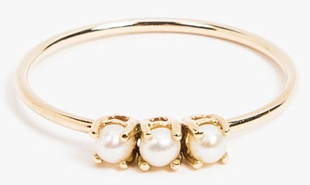 A graceful basket-set ring that'll match your pearly whites perfectly.