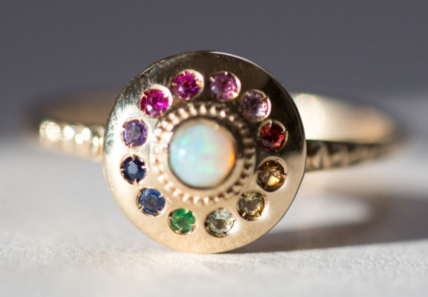 A rainbow UFO-like ring that's made up of too many gemstones to list.