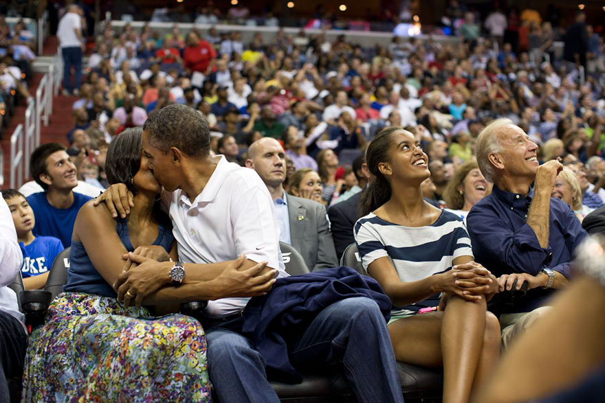 """Barack Obama Kisses Michelle Obama For The """"Kiss Cam"""" While Attending The U.S. Men's Olympic Basketball Team's Game Against Brazil At The Verizon Center In Washington, On July 16, 2012"""