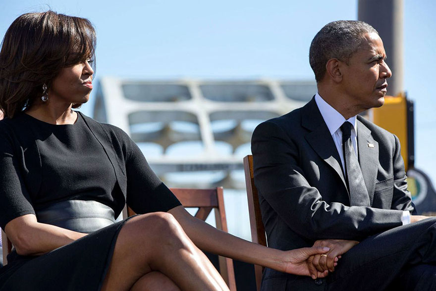 The President And First Lady Hold Hands As They Listen To The Remarks Of Rep. John Lewis Commemorating The 50th Anniversary Of Bloody Sunday And The Selma To Montgomery Civil Rights Marches On March 7, 2015