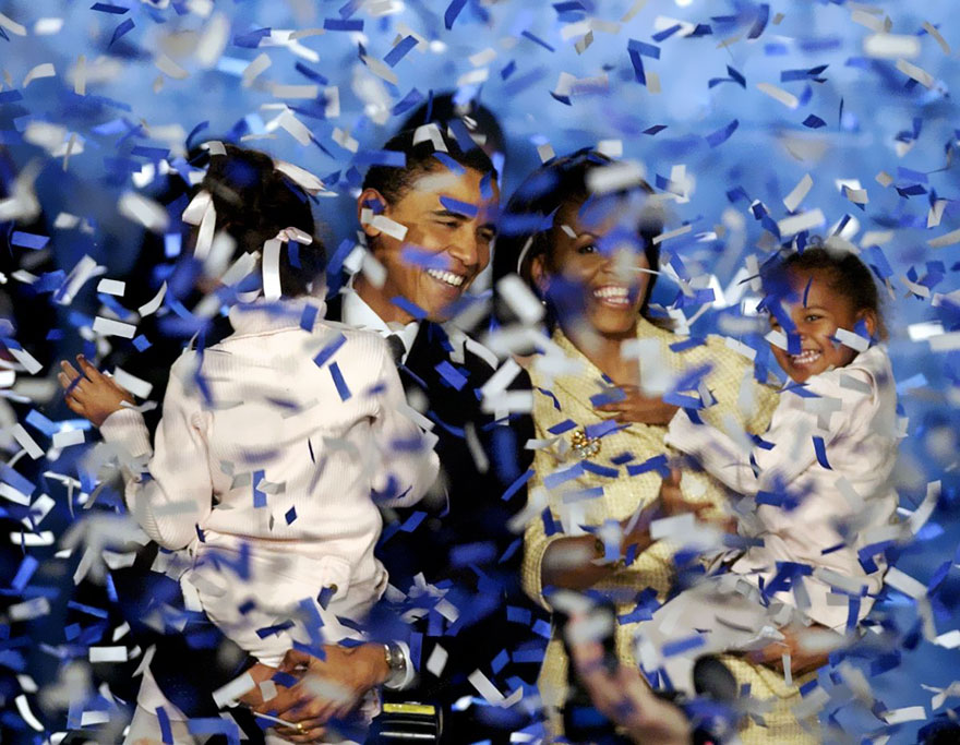 Barack Obama, Holding His Daughter Malia, 6, And His Wife Michelle, Holding Their Daughter Sasha, 3, Are Covered In Confetti After Obama Delivered His Acceptance Speech In Chicago, Nov. 2, 2004