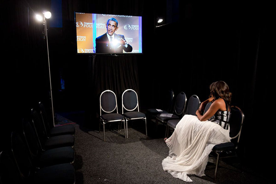 Michelle Obama Sits Back Stage, Watching President Barack Obama Deliver Remarks At The Congressional Black Caucus Foundation's 44th Annual Legislative Conference Phoenix Awards Dinner In Washington On Sept. 27, 2014