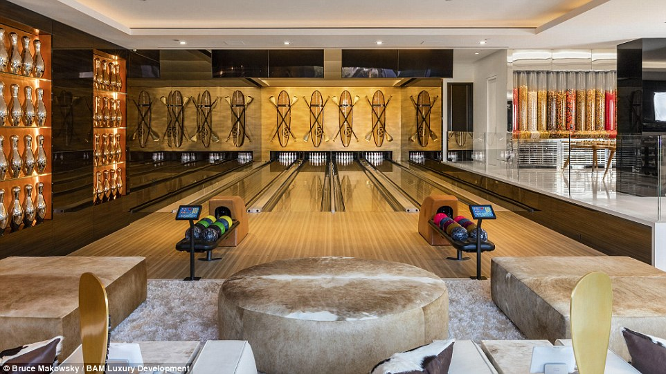 Next to the candy room, guests can walk to the property's private bowling alley (pictured) with custom-made furnishings
