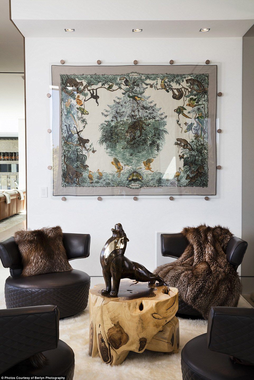 Inside the home is thisHermes Equateur Blanket, made out of cashmere and hand-embroidered with fine beads and pearls. IT has beenencased between starfire glass panels with custom-made standoffs