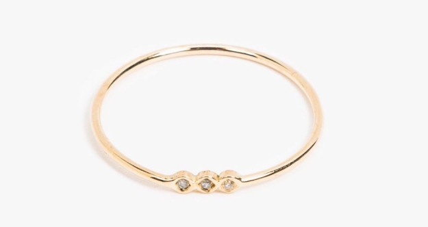 A delicate yellow-gold ring that has just enough sparkle.