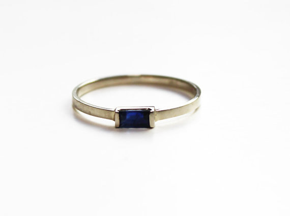 A sapphire baguette so that they'll always have their something blue.