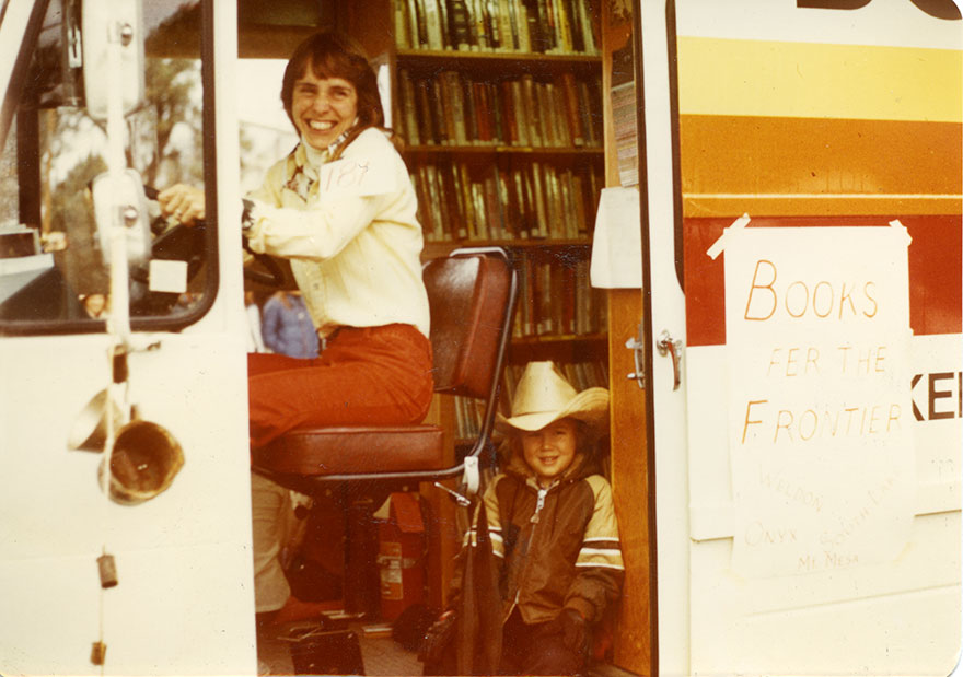 Chris Junapa Standing In The Bookmobile, 1980