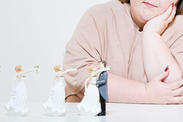 Woman and wedding figurines