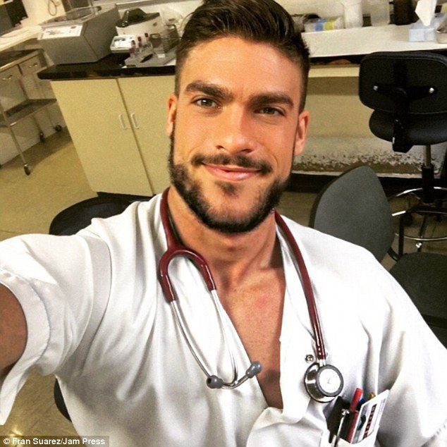 Hunky: Nurse Fran Suarez, from Madrid, Spain, has won thousands of Instagram followers with his sexy selfies. Some images show Mr Suarez with a stethoscope draped around his neck