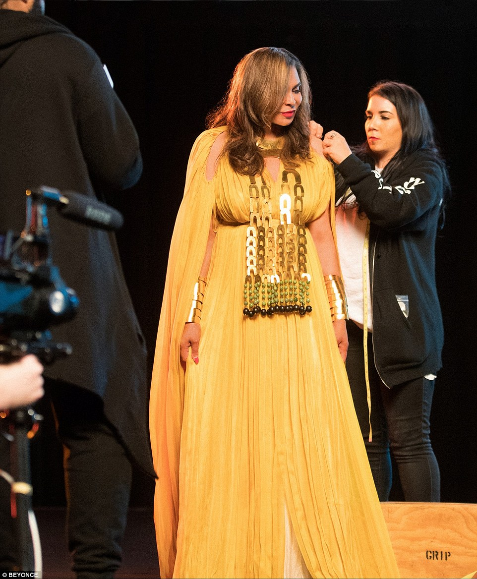 Announcing Bey's performance, was her mother Tina Knowles, who spoke proudly of her famous daughter (seen here backstage)