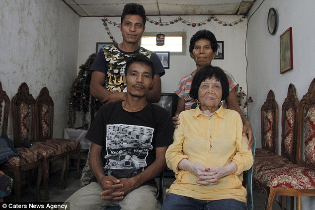 Due Indonesia being a conservative society, there were some strong opposition from their families to their relationship. But the lovers eventually won over their families with their determination and loyalty for each other. Pictured above, Dandel and Potu pose with Dandel's mother, Magdalena (back right) and brother, Oscar (back left)