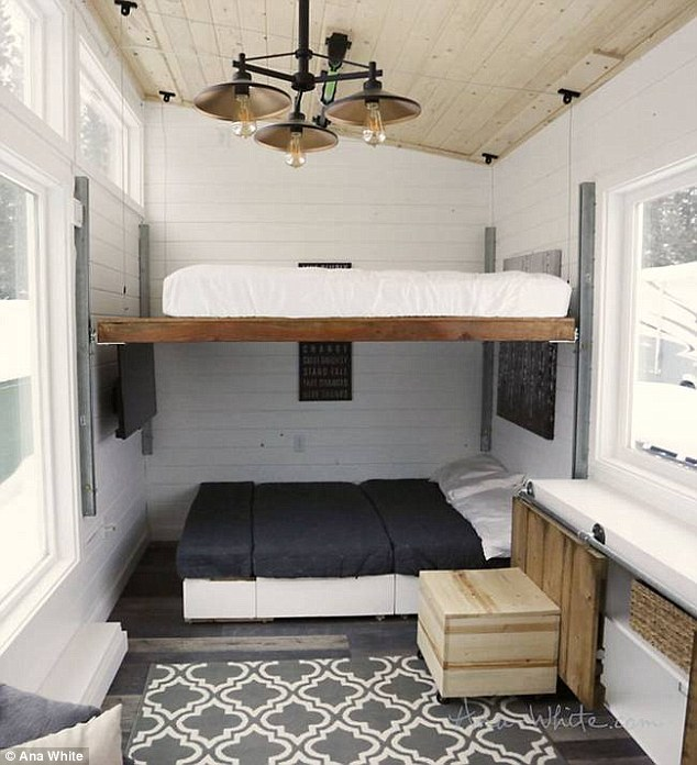 The space can be converted into full bunk beds when the sectional sofa is arranged properly