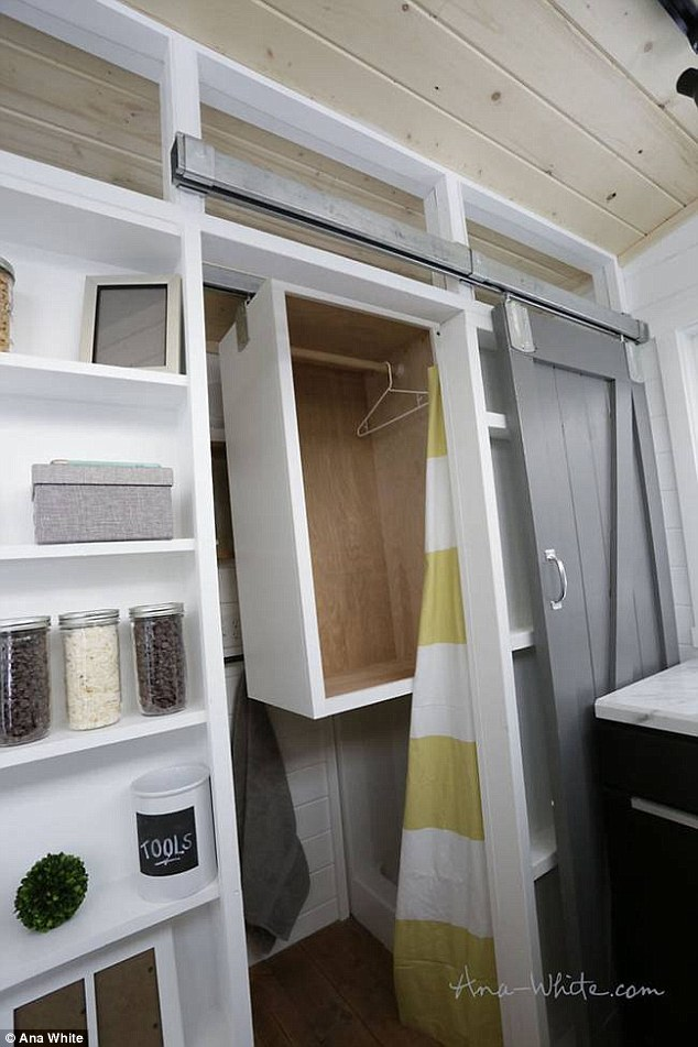 In the bathroom, a cubic wardrobe which hangs on a sliding rail can be pulled out of the shower stall and slide over to the other end of the room