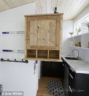 A cabinet in the welcome area slides out to serve secondly as a pantry for the kitchen