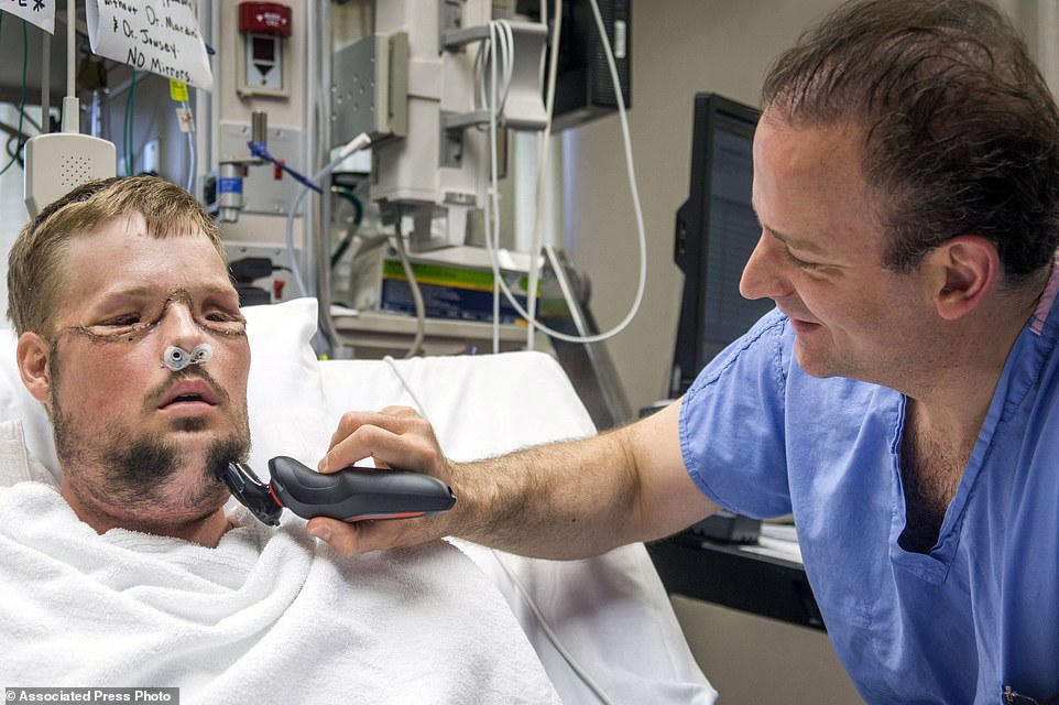 Getting back to normal: Dr. Samir Mardini shaves Andy Sandness, days after leading a team that performed the first face transplant surgery at the hospital