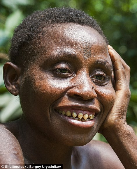 A women from a Baka tribe of pygmies in the Dzanga-Sangha Forest Reserve, Central African Republic. Human tooth sharpening has been practiced by many cultures throughout history - sometimes for spiritual or class reasons, and in other cases to imitate animals