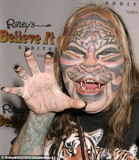 Dennis Avner, also known as the Stalking Cat, was a Nevada man famed for his extreme body modifications who died in 2012 at the age of 54