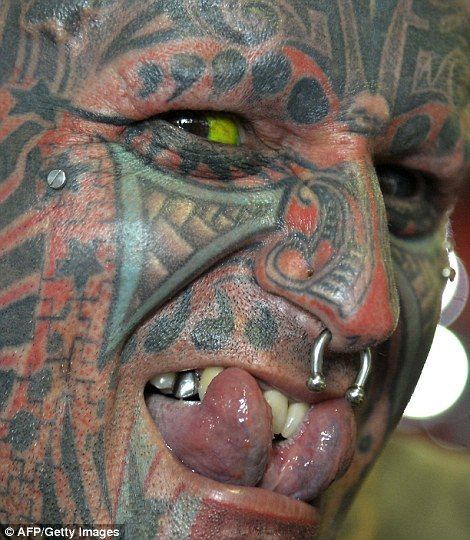 Argentinian Victor Peralta, who has 90 per cent of his body tattooed, displaying his split tongue