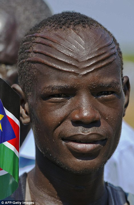 A man from the Abyei region of Sudan with scars inflicted on his forehead - a traditional rite of passage which dates all the way back to early man
