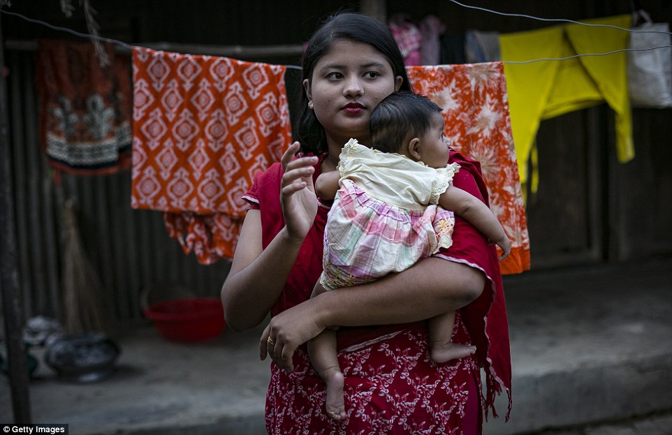 Young Bangledeshi mother Meghla, 17, married her 30-year-old husband when she was just 15. Her father forged her birth certificate so she could marry