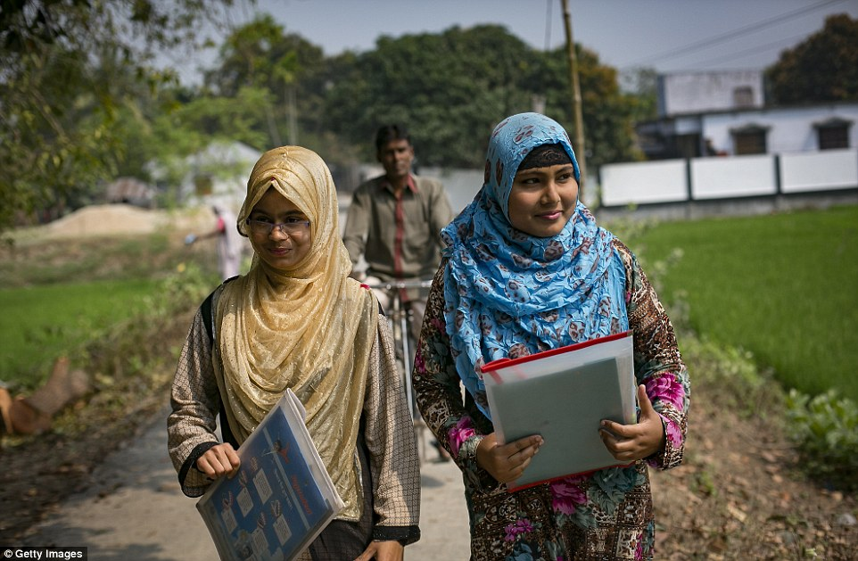Rani (blue scarf) walks with a friend with her father following on a bicycle to catch a rickshaw to take a school exam.When her boyfriend's family, who are politically connected in the area, discovered the relationship, they insisted for the couple to get married. The boy threatened to kill himself while his family said they would kidnap her if she did not agree