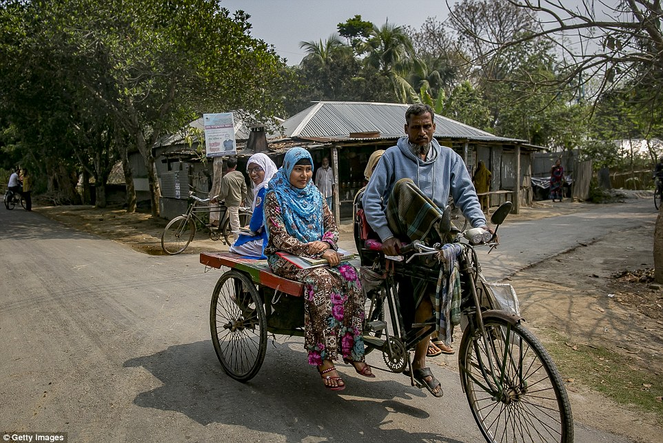 Rani  rides on a rickshaw.She said the harassment was so bad that she can't walk around her village without wearing a burka