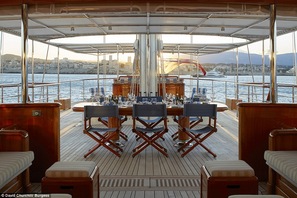 Up on the vast deck a  table is available for al fresco dining as well as numerous individual sun beds, a full tanning bed and a covered area with deck couches