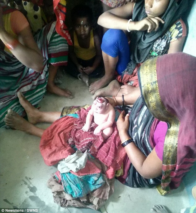 Shocked: The mother-of-four, from Kathihar in the North Indian state of Bihar, initially demanded midwives remove him from sight - but later chose to nurse him