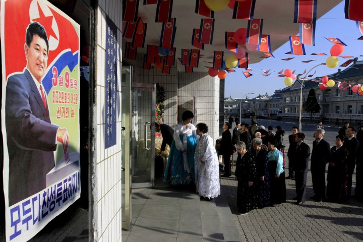 North Korean voters line up to cast their ballots to elect deputies for the Supreme People's Assembly in Pyongyang on March 9, 2014