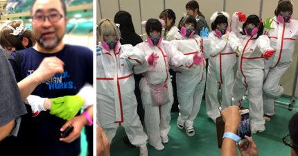 日本偶像團體辦「粉絲擁抱會」都穿著防毒衣不肯碰粉絲,把粉絲當危險細菌作戰成功!
