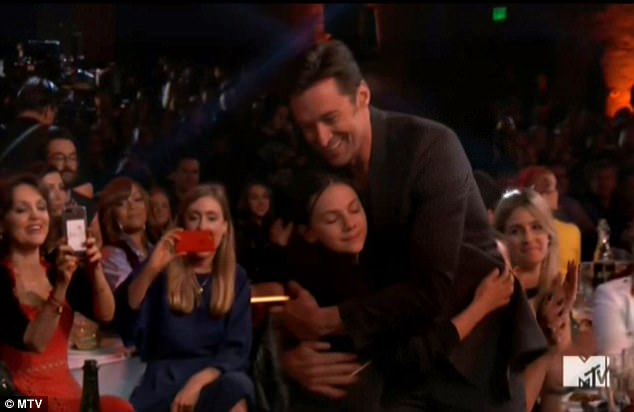 Big hug! Hugh and Dafne gave each other a congratulatory embrace before making their way to the stage to accept their well deserved award