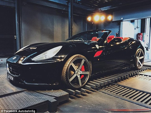 The showroom is filled with Ferraris, like this jet-black California. Ironically, there's a Coca-Cola vending machine in the background