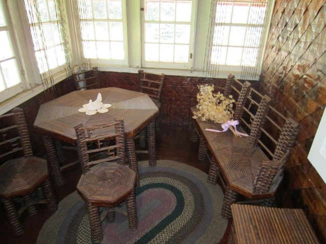 Others have been carefully fashioned into tables and chairs. All in all, Stenman estimates that he used 100,000 newspapers to build his house and furnishings.