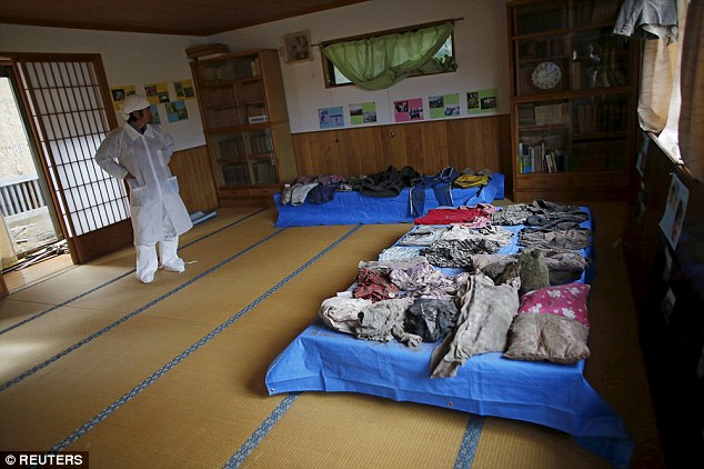 He layed out the clothing and belongings of his family he has recovered so far