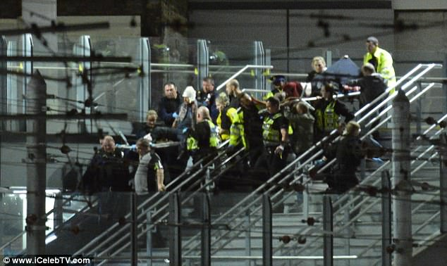 Witnesses told of nuts and bolts tearing into young music fans when the blast was detonated in the foyer area of Manchester Arena. Pictured: Concert-goers flee from the incident